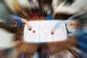 Children playing on air hockey — Stockfoto
