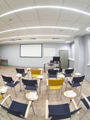 Empty classroom with сhairs and notepads — Stock Photo