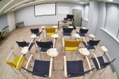 Empty classroom with сhairs and notepads — Stockfoto