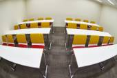 Tables and chairs in an empty classroom — Stock Photo
