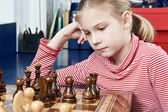 Girl thinking in chess game — Foto Stock