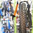 Tire tread of front wheel sports mountain bike — Stock Photo #67600157