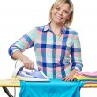 Beautiful woman housewife ironed clothes — Stock Photo #67783347