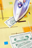 Ironing dollars banknote — Stock Photo