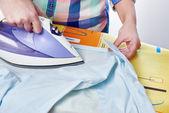 Woman ironed shirt — Stock Photo