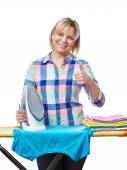Beautiful woman housewife ironed clothes and showing thumbs up — Stock Photo