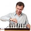 Happy man playing chess isolated — Stock Photo #68870703