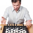 Man emotionally perturbed game combination in chess — Stock Photo #68870923