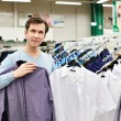 Man chooses shirt in shop — Stock Photo #69132573