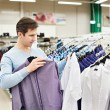 Man chooses a shirt in shop — Stock Photo #69132575