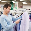 Man looking at price tag of goods — Stock Photo #69132691