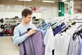 Man chooses a shirt in shop — Stock Photo