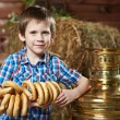Little boy with bread-rings around large samovar — Stock Photo #69683479