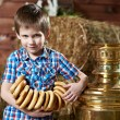 Little boy with bread-rings around large samovar — Stock Photo #69683535