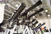 Different types of telescopes at exhibition — Stock Photo