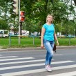Woman crossing street is dangerous at red light — Stock Photo #75639821