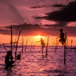 Traditional fishermen on sticks — Stock Photo #78008976