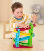 Boy playing with cars. — Stock Photo