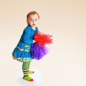 Little girl with multi-colored tinsel. — Foto Stock