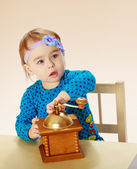 Girl sitting at the table — Stock Photo