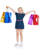 Girl raised her hands holding them in shopping bags — Stock Photo