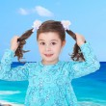 Cute little girl in a blue dress — Stock Photo #53225911
