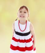 Girl in a bright red beads — Stock Photo