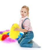 Little girl with multi-colored tinsel. — Stock Photo