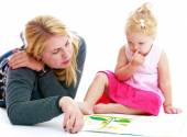Mother and little daughter playing an exciting game — Stock Photo