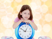 Little girl with a big clock. — Foto de Stock