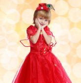 Fashionable little girl in a bright red dress . — Stock Photo