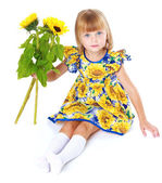 Charming girl in a bright dress. — Stock Photo