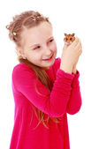 Smiling little girl holding hands in front of a hamster. — Stock Photo