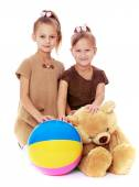Two sisters with their favorite toys. — Stock Photo