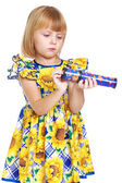Little girl with interest the telescope. — Stock Photo