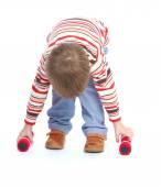 Little boy raises his arms dumbbells. — Stock Photo