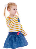 Adorable little girl looks wistfully into the distance. — Stock Photo