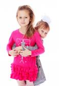 Charming girl sisters smiling cheerfully. — Stock Photo