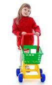 Elegant little girl rolls the cart. — ストック写真