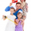 Family mother father and two daughters in the playful style phot — Stock Photo #65494465