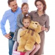 Family mother father and two daughters, playful school pictures. — Stock Photo #65494553