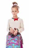 Very serious little schoolgirl with satchel in hand. — Stock Photo