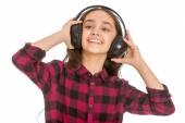 Grins teen girl holding hands big black headphones worn on the h — Stock Photo