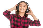 Grins teen girl holding hands big black headphones worn on the h — Foto de Stock