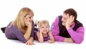 Happy parents admire its charming little daughter — Stock Photo