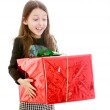Happy girl holding a big red front beautifully packaged box — Stock Photo #69450557