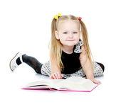 Adorable little girl with pigtails reading a book. — Stock Photo