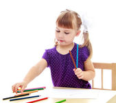 Cute little girl drawing with markers at the table — Stock Photo