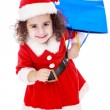 Little girl in costume of Santa Claus with packages — Stock Photo #78640976