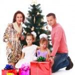 Happy family at the Christmas tree — Stock Photo #78731008